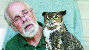 Frank Read, from the Raptor Center at Bays Mountain Park in Kingsport, introduces Bobo, a Great Horned Owl, to children attending the 2012 Xtreme Roan Adventures
