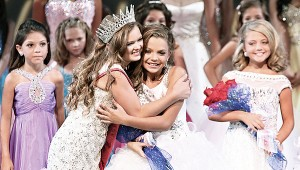 Photo Contributed Cagney Bennett, right, receives a congratulatory hug from her good friend, Hayley Hood, Miss Pre Teen United States 2013. Cagney was awarded third runner-up out of 22 delegates in the 2014 Little Miss United States Pageant.