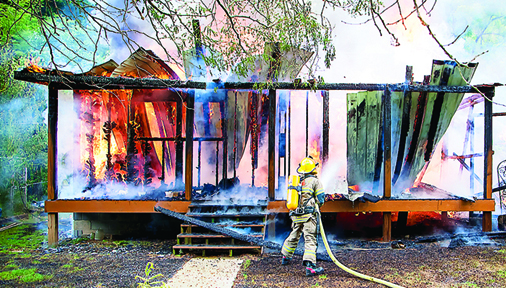 Photo by Brandon Hicks A home on Bishop Hollow Road was destroyed in a fire Thursday afternoon. Firefighters have not been able to determine how the fire started.