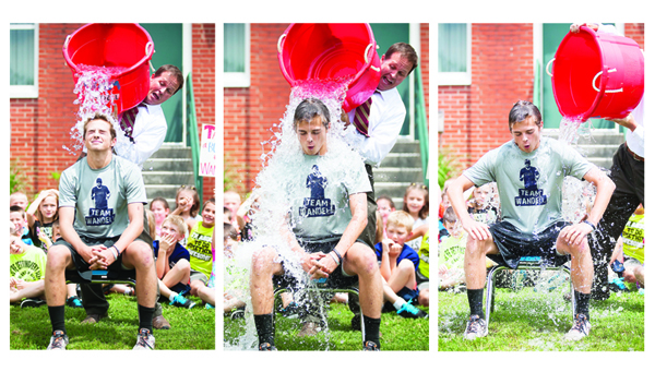Photos by Brandon Hicks East Side Elementary School students react as T. J. Brown dumps ice water over his son Connor Brown's head for the Ice Bucket Challenge on Wednesday. The challenge seeks to raise awareness about ALS, also known as Lou Gehrig's Disease. East Side Principal Josh Wandell was diagnosed with ALS last year.