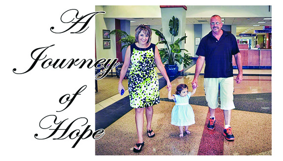 Angie and Earl Odom and their daughter Hope walk into the Florida hospital where Hope was born.