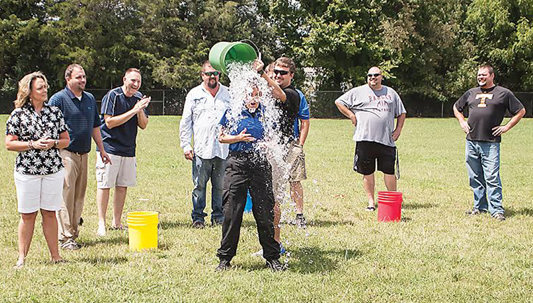 Photo by Brandon Hicks Deputy Michele Meade, the school resource officer for Hunter Elementary School, takes the Ice Bucket Challenge Friday afternoon at the school. She was one of 10 individuals to participate in the challenge.