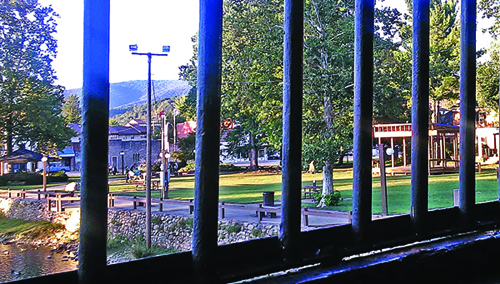 The Covered Bridge Park stage can be glimpsed through a window on the bridge itself.