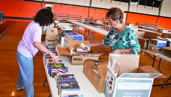 Photo by Brandon Hicks Alta Barwick and Robin Loessberg organize books that will be sold in the Friends of the Library book sale.