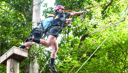 Photo by Brandon Hicks Hampton High School student Jared Wiltshire and Melenda Perry of Elizabethton High take the double leap of faith during a Chamber team-building event at Doe River Gorge.