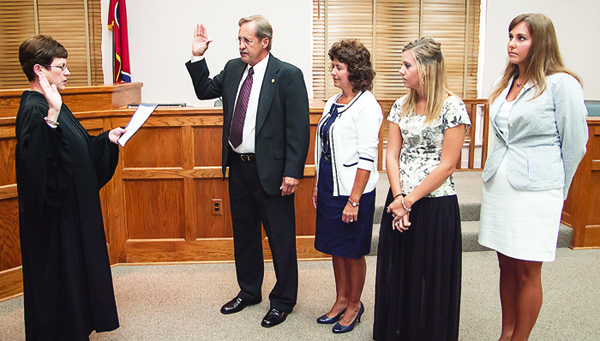 Photo by Brandon Hicks Newly elected Sheriff Dexter Lunceford, second from left, is administered his oath of office by Circuit Court Judge Jean Stanley on Friday afternoon as his wife and daughters look on.