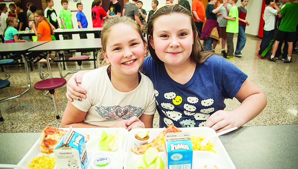 Photos by Brandon Hicks Christina Melton, left, and Faith Shell enjoy lunch together at Happy Valley Elementary School.