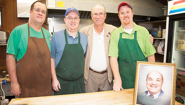 Photo by Brandon Hicks The Williams Family - Mar, Dave, Kent and John - have worked since 1995 to preserve the legacy of Dino's restaurant. The founder of the eatery, Dino Senesi, is shown in the portrait.