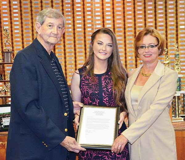 Star Photo/Rebekah Price  Nursing Scholarship Chairman Ken Swift and Elks Lodge President Jacklyn Morris presented Hannah Smith with an $8,000 scholarship at Dino's Restaurant Thursday.