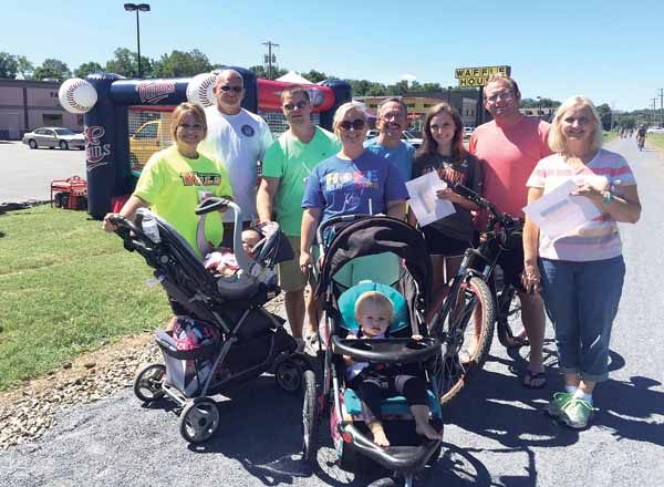 Photo Contributed  Traffic on the Tweetsie Trail spanned far and wide through Elizabethton Saturday during the second annual Tweetsie Trail Treasure Trip. Pictured, participants are all smiles after stopping by one booth near Pizza Inn.
